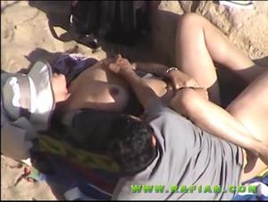 Hot teen couple caught fucking on the beach